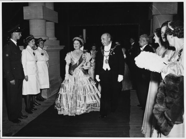 ROYAL TOUR OF SOUTH AFRICA AND RHODESIA: Queen Elizabeth attends the Civic Ball, City Hall, Durban. She makes her entrance on the arm of the Mayor, Rupert Ellie Brown