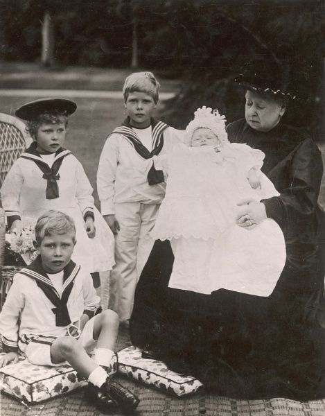 Royal group at Osborne House, Isle of Wight in 1899 showing Queen Victoria with her heirs. From left: sitting on cushion, Albert George - later George VI, Princess Mary, later Princess Royal, the future Edward VIII, Henry, later Duke of Gloucester