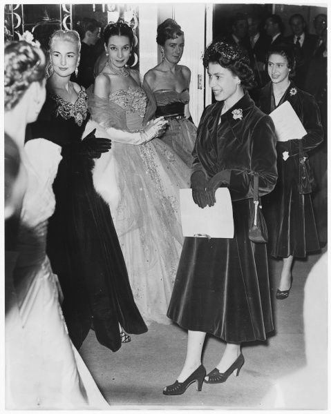 The Queen and Princess Margaret at a fashion show at Claridges, London in 1952. Three models on the left all wear designs by Victor Stiebel (1907-1976)
