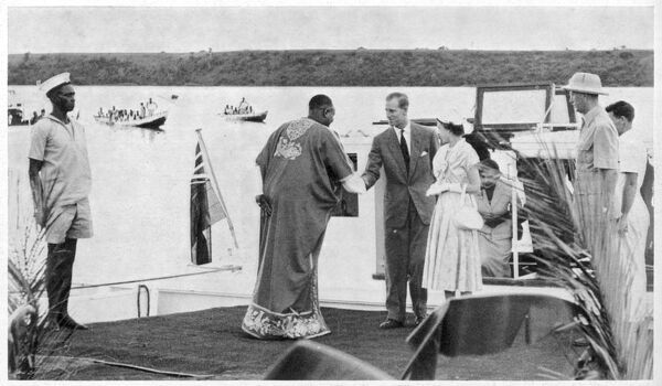 ELIZABETH II arrives with the Duke of Edinburgh who shakes hands with the Mugabi of Ankole at Katunguru during a short visit to Uganda in 1954