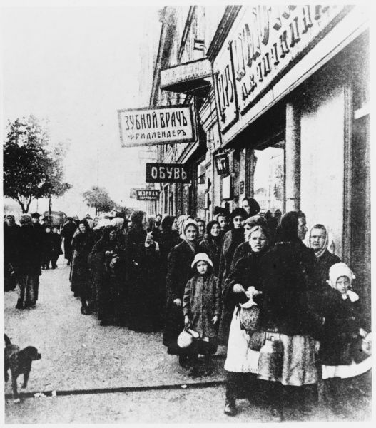 Russian women and children queuing for milk