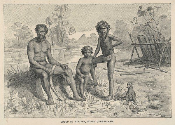 A group of natives of North Queensland, with their dog : the father carries a boomerang, the daughter wears a necklace