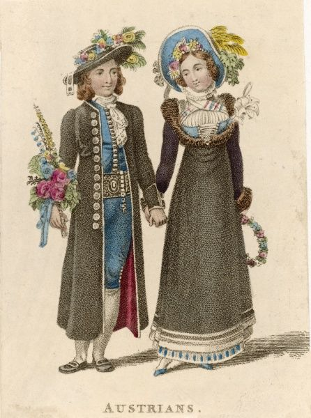 A bride and groom in their wedding costume