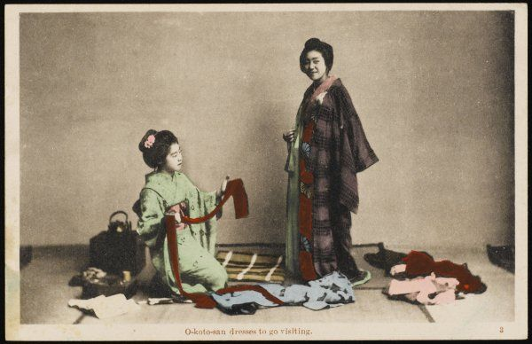 A Japanese lady dresses for a visit, assisted by her maid
