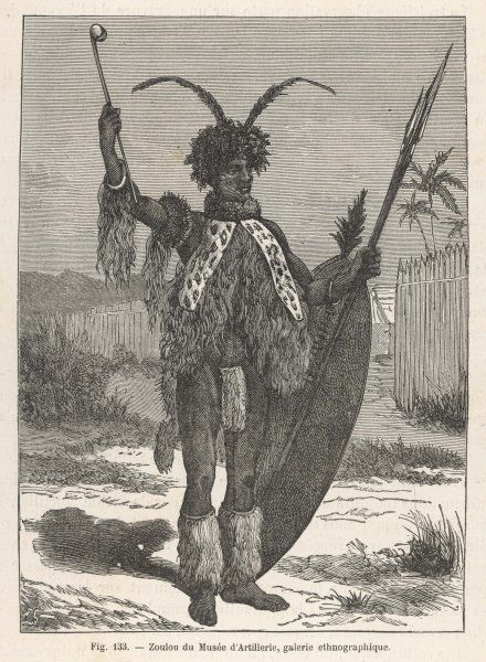 A Zulu warrior in traditional attire, with spears, shield and club