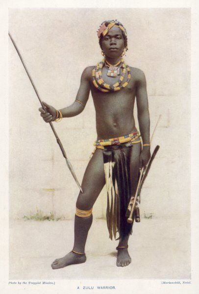 A young Zulu warrior, wearing colourful ornaments and carrying a spear