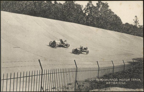 Two racing cars compete on the new circuit at Brooklands, near Weybridge, Surrey, designed for the testing of vehicles but used most famously as a race track