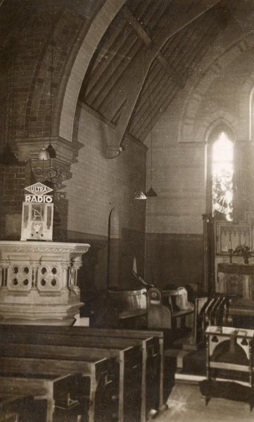 An 'Ultra' radio set up in Hightown Parish Church, Castleford, Yorkshire, so that the congregation can follow the celebrations for the Silver Jubilee of King George V. Date: 1935