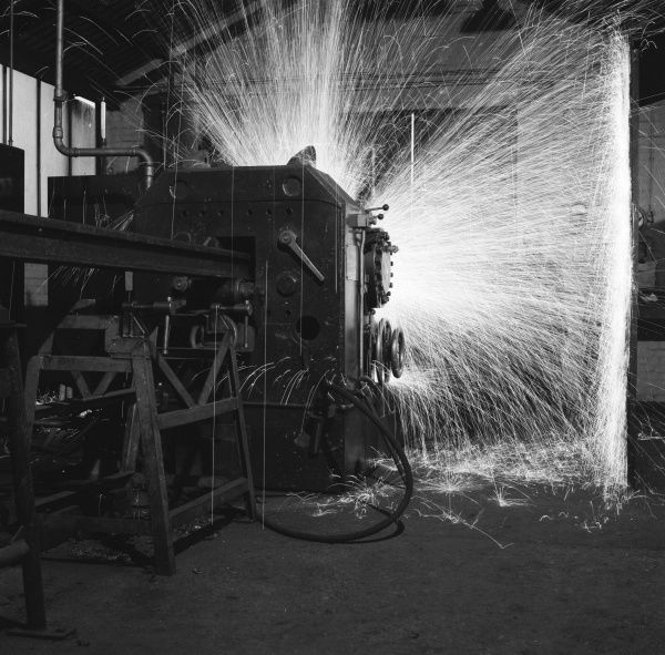 A fantastic photograph showing the sparks flying up during the butt welding of railway rails. Photograph by Heinz Zinram