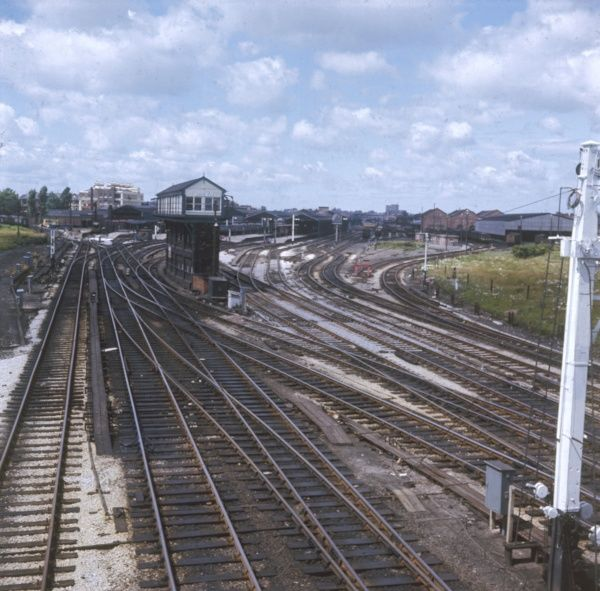 A confusion of railway lines and a signal box, hopefully operated by someone who knows what they're doing! Date: 1960s