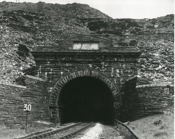 Entrance to a railway tunnel, built in 1879, which goes right under the main workings of Oakeley Slate Quarry, Blaenau Ffestiniog, North Wales. The tunnel is almost two and a half miles long, and the portal seen here is made of Blaenau slate