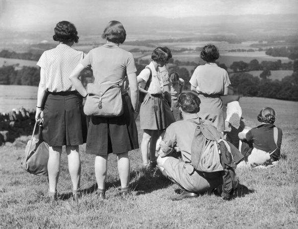 A party of hikers, mostly young women, resting on the Sidlaw Hills, near Perth, Scotland