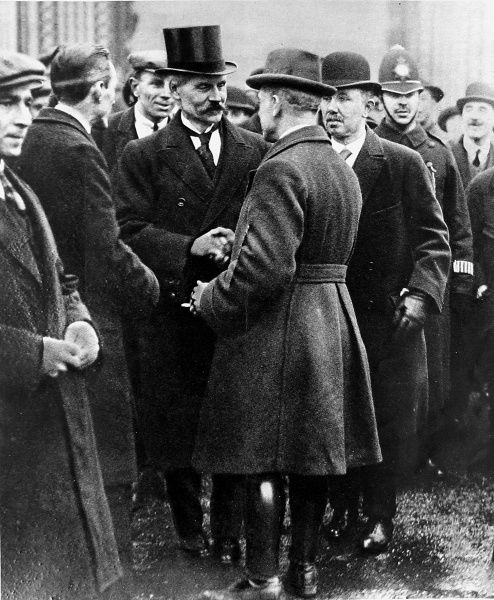 Photograph of (James) Ramsay MacDonald (on left in top hat) being congratulated by members of the Labour Party as he leaves Buckingham Palace after accepting the office of British Prime Minister, 22nd January 1924