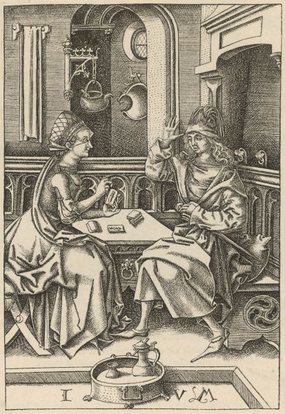 READING THE TAROT A 15th century fortune-teller reads the cards for an alarmed client