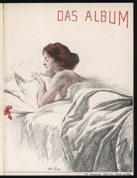A woman reading a book in her bed with white sheets