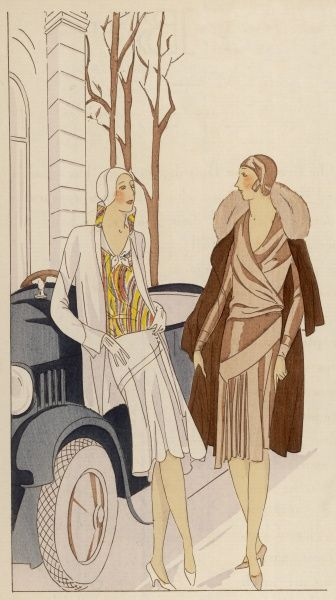 Preparing for an outing in their motor-car, one lady wears a printed velvet ensemble by Worth, her companion a satin crepe and woollen afternoon ensemble