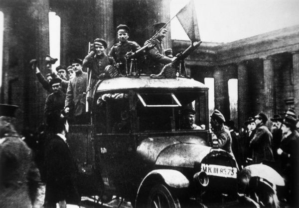 The Red Flag is flown at the Brandenburg Gate by German Communists who hoped that the dissolution of Imperial Germany might be turned into a more radical revolution