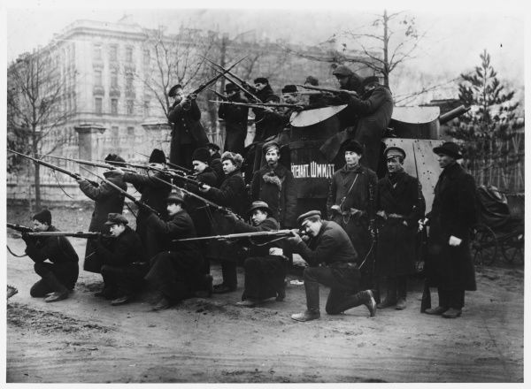 Putilov Red Guard commandeer a tank from the Junkers (Young Cadets), name if after Lieutenant Schmidt a hero of the 1905 rising, and strike dramatic poses for the camera