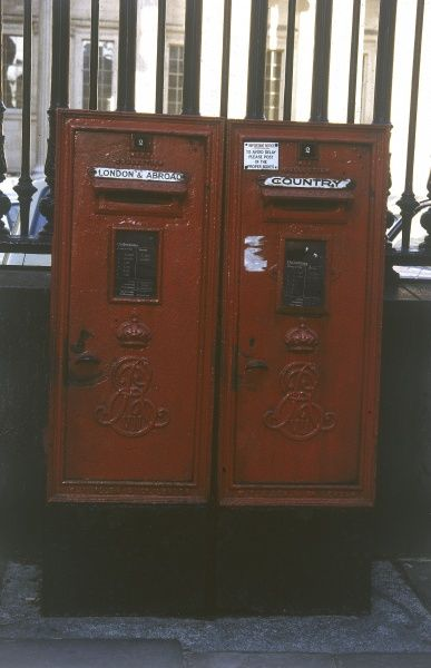 Two typical British red post boxes. Date: 1979
