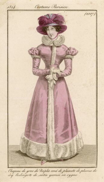 A pink redingote trimmed with swans down. Worn with a white ruff collar, broad-brimmed hat trimmed with red plumes & pink shoes trimmed with swans down. She holds a handkerchief