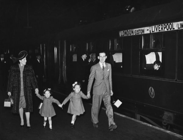 Family of refugees at a train station during World War II