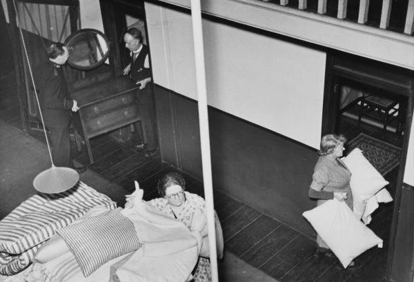 Cubicles in a Salvation Hostel in London are hurriedly furnished to receive refugees during World War II