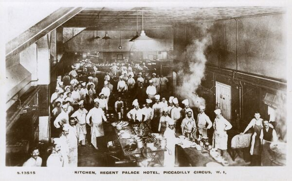 Regent Palace Hotel Kitchens, Piccadilly, London - 'The Brigade' in action. The Hotel opened in 1915 and closed in 2006. Over 50 people can be seen working in the kitchen in this shot, hence the name 'Brigade' !! Date: circa 1916