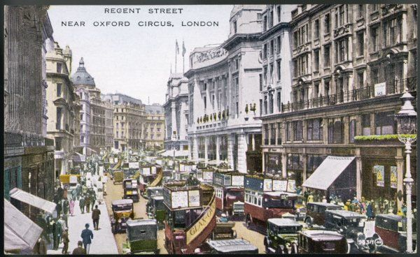 Looking north up Regent Street, London, with buses, cars and cabs