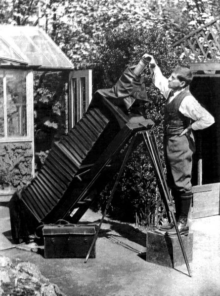 Reginald Malby (1882-1924), official photographer to the Royal Horticultural Society, using a giant camera in his garden at Woodford, Essex
