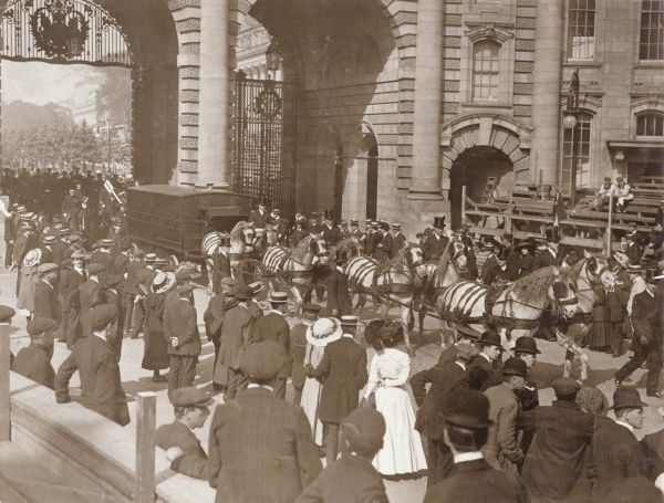 A rehearsal of King George V's Coronation Procession, passing through the Mall Gates -- the first time these gates have been used in this way