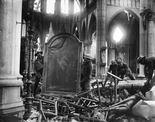British soldiers removing sacred artworks from Armentieres church for safety on the Western Front in France during World War I in February 1918