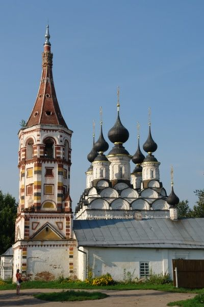 View of the old belfry and towers of a small renovated church in Suzdal, Russia