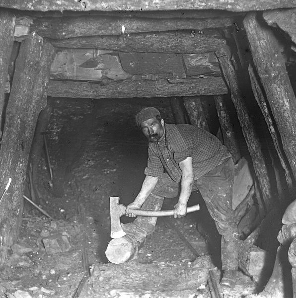 A miner repairing pit props in the Plas y Coed Level, South Wales