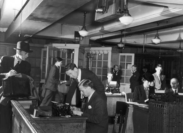 The reporter's room at the Daily Mail showing journalists busy at their typewriters