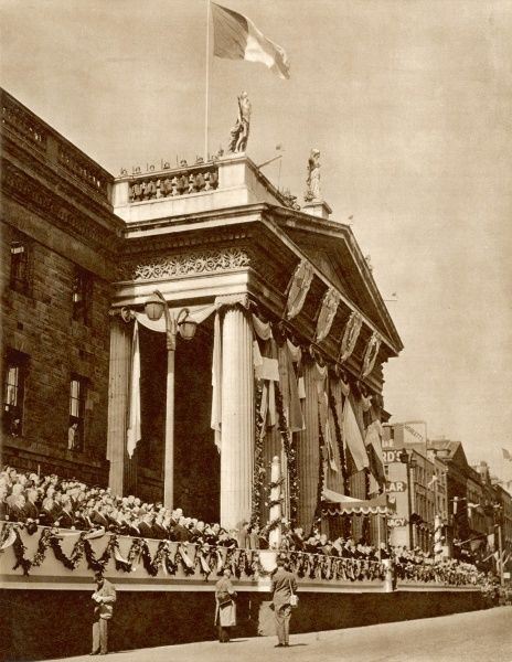 Eire becomes a republic on the anniversary of the Easter Rising of 1916: the General Post Office in O'Connell Street, focal point of the rebellion, here the saluting-base for the military parade in Dublin on Easter Monday. The president Mr