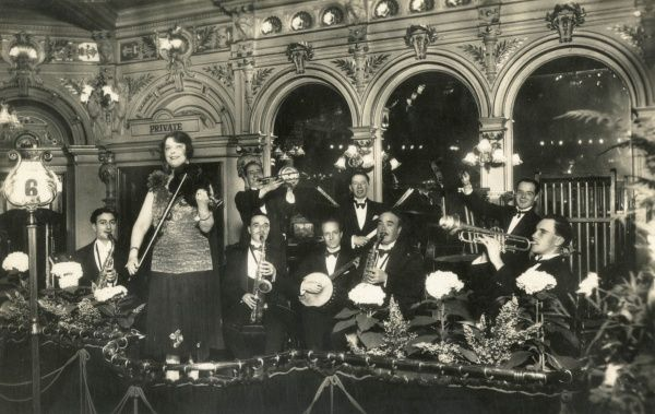 Restaurant Frascati Orchestra, 32 Oxford Street, London W1, with Madame Cecile Couturier, Director, on the violin, and her happy band of men on their various instruments. Frascati's was a large, luxury restaurant offering cosmopolitan cuisine