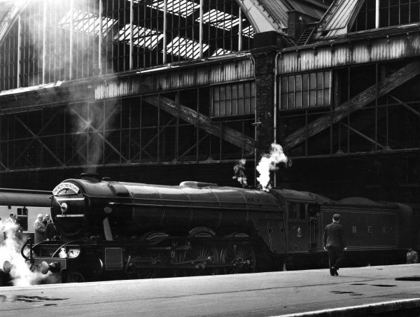 The 'Retford Rover' steam locomotive on the 'Flying Scotsman' route from King's Cross, London, England, to Edinburgh Waverley, Scotland. Photographed at King's Cross. Date: 1960s