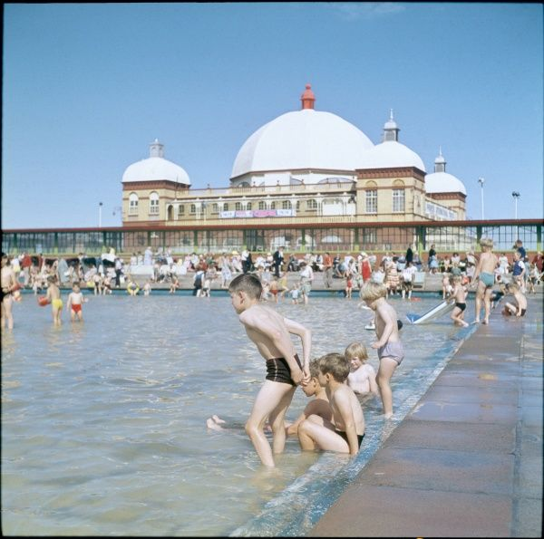 Children enjoying themselves in the lido next to the pier at Rhyl, Flintshire, north Wales