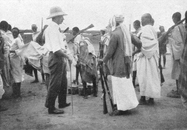 Richard Corfield, British colonial and leader of the mounted Camel Constabulary, distributing arms to 'friendlies' in Burao Fort, Somalia just before the evacuation