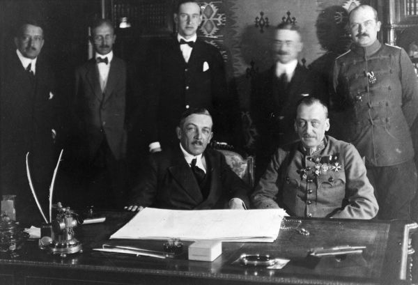 Richard von Kuhlmann (1873-1948), German Foreign Secretary, and Count Ottokar von Czernin (1872-1932), Austro-Hungarian Foreign Minister, sitting at the table where they signed the peace treaty of Brest Litovsk, Russia (now Brest, Belarus)