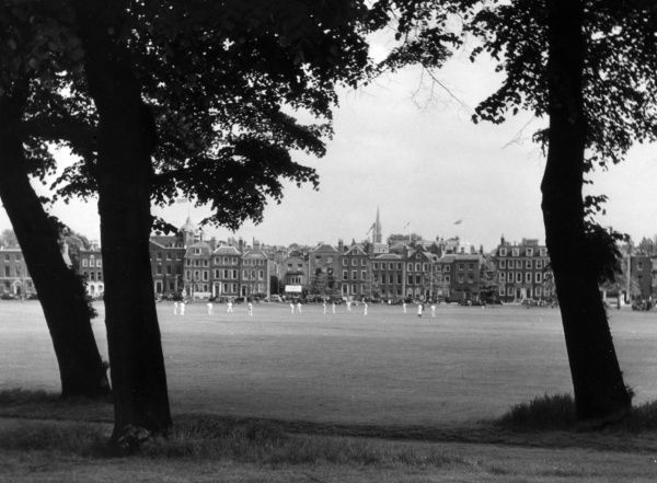 A civilised game of English cricket on Richmond Green, Surrey. Date: 1950s