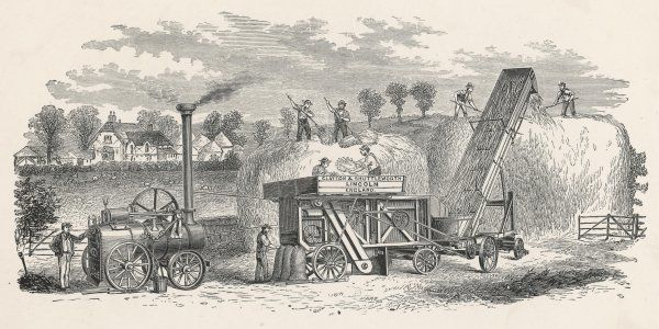 Rick-making machine by Clayton & Shuttleworth of Lincoln, powered by an elegant steam engine