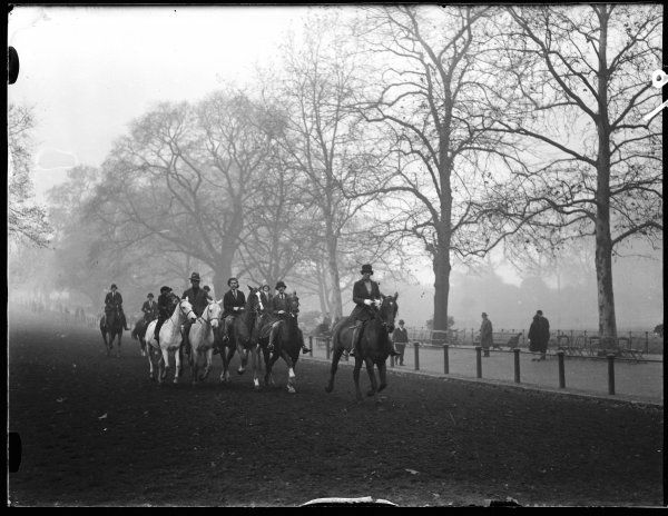 Well-to-do horse riders enjoy a morning canter in Rotten Row, Hyde Park, central London