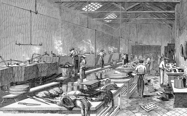Scene showing Ritchie & M'Call's preserved meat establishment in Houndsditch, London. Various workers wearing caps and aprons are tending vats while meat cuts and carcasses fill the tables and worktops