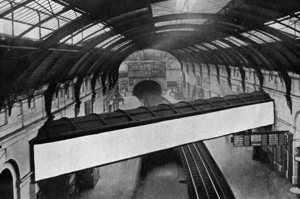 A conduit containing the overflow from the Serpentine running above the platforms at Sloane Square underground station. Date: 1909