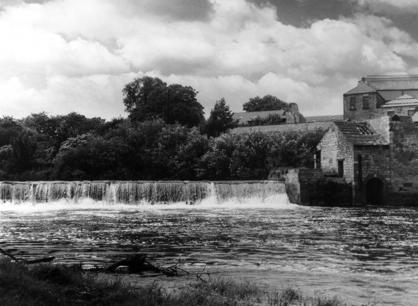 A weir on the River Wharfe, at Wetherby, Yorkshire, England. Date: 1950s