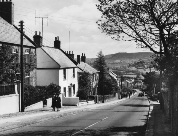 The picturesque road into Charmouth, Dorset, a holiday resort on the border with Devon