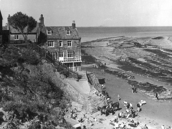 Idiosyncratic coastal village in North Yorkshire, with a history of smuggling, but little to prove the myth that Robin Hood kept a boat in the bay to make a quick sea escape