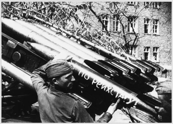 Russian soldiers loading a Katyusha Rocket (inscribed 'To the Reichstag') during their advance into Berlin