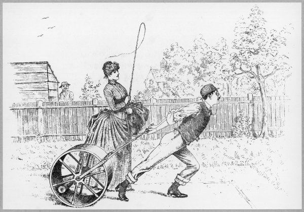 A lady makes sure that her husband rolls the lawn correctly